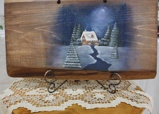 木製ボードに描かれたアート作品.jpg
